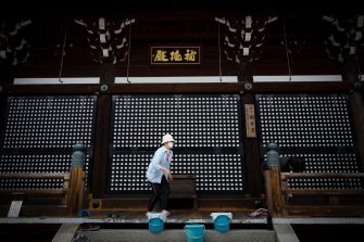 epa08442563 A woman wearing a face mask cleans a floor at Kiyomizudera temple in Kyoto, western Japan, 25 May 2020. Japan on 25 May ended its nationwide state of emergency by lifting restrictions in remaining areas including the capital Tokyo. The world's third-biggest economy is set to reopen gradually as the number of new infections decline day by day.  EPA/DAI KUROKAWAA