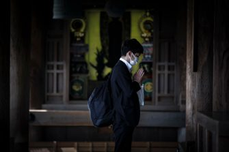 epa08442573 A man prays as he visits Kiyomizudera temple in Kyoto, western Japan, 25 May 2020. Japan on 25 May ended its nationwide state of emergency by lifting restrictions in remaining areas including the capital Tokyo. The world's third-biggest economy is set to reopen gradually as the number of new infections decline day by day.  EPA/DAI KUROKAWAA