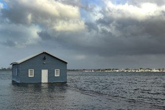 PERTH, AUSTRALIA - MAY 25: The jetty of the Blue Boat House is seen submerged at Crawley on May 25, 2020 in Perth, Australia. Ex-Tropical Cyclone Mangga has brought heavy wind, rain and waves along Western Australia's coastline after combining with other cold fronts to create unprecedented storm conditions. State Emergency Services have answered hundreds of calls for help with structural and roof damage since Sunday while thousands of homes and businesses have been left without power.  (Photo by Paul Kane/Getty Images)