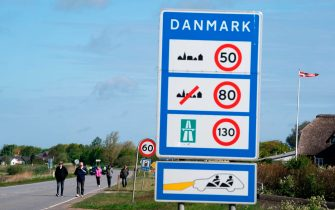People walk on a street connecting Denmark and Germany as they take part in a demonstration at the border crossing in Saed, near Toender, Denmark, on May 17, 2020, asking to open the border between Denmark and Germany. - Denmark closed its borders towards Sweden and Germany on March 14, 2020, in a measure to limit the spread of the new coronavirus / COVID-19 pandemic. (Photo by Claus Fisker / Ritzau Scanpix / AFP) / Denmark OUT (Photo by CLAUS FISKER/Ritzau Scanpix/AFP via Getty Images)