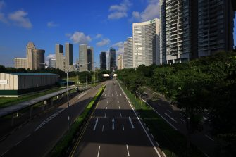 SINGAPORE - MAY 26:  A general view of an unusually quiet road leading to the central business district on May 26, 2020 in Singapore. Singapore is set to ease the partial lockdown measures against the coronavirus (COVID-19) pandemic after 1 June in three phases to resume activities safely after it sees a decline in the new infection cases in the community. Singapore's gross domestic product (GDP) is expected to shrink as much as 7 percent this year as the country battles the slump in global trade and travel amid the coronavirus pandemic, according to the government report in the local media today.  (Photo by Suhaimi Abdullah/Getty Images)