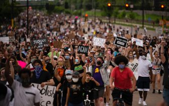 MINNEAPOLIS, MN - MAY 26: Protestors march on Hiawatha Avenue while decrying the killing of George Floyd on May 26, 2020 in Minneapolis, Minnesota. Floyd was killed yesterday while in the custody of Minneapolis Police. (Photo by Stephen Maturen/Getty Images)