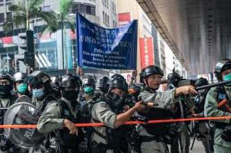 HONG KONG, CHINA - MAY 27: Police use pepper spray projectile during a Lunch With You rally in Central district on May 27, 2020 in Hong Kong, China. Chinese Premier Li Keqiang said on Friday during the National People's Congress that Beijing would establish a sound legal system and enforcement mechanism for safeguarding national security in Hong Kong.(Photo by Anthony Kwan/Getty Images)