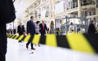 US President Donald Trump, First Lady Melania Trump, followed by US Vice President Mike Pence, arrive at the Kennedy Space Center in Florida on May 27, 2020. - US President Donald Trump travels to Florida to see the historic first manned launch of the SpaceX Falcon 9 rocket with the Crew Dragon spacecraft, the first to launch from Cape Canaveral since the end of the space shuttle program in 2011. (Photo by Brendan Smialowski / AFP) (Photo by BRENDAN SMIALOWSKI/AFP via Getty Images)