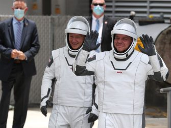 CAPE CANAVERAL, FLORIDA - MAY 27: NASA astronauts Bob Behnken (R) and Doug Hurley (L) walk out of the Operations and Checkout Building on their way to the SpaceX Falcon 9 rocket with the Crew Dragon spacecraft on launch pad 39A at the Kennedy Space Center on May 27, 2020 in Cape Canaveral, Florida. The inaugural flight will be the first manned mission since the end of the Space Shuttle program in 2011 to be launched into space from the United States.  (Photo by Joe Raedle/Getty Images)