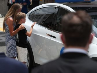 CAPE CANAVERAL, FLORIDA - MAY 27: NASA astronaut Karen Nyberg and her son Jack say goodbye to husband and dad NASA astronaut Doug Hurley after he got into a Tesla vehicle after walking out of the Operations and Checkout Building on their way to the SpaceX Falcon 9 rocket with the Crew Dragon spacecraft on launch pad 39A at the Kennedy Space Center on May 27, 2020 in Cape Canaveral, Florida. The inaugural flight will be the first manned mission since the end of the Space Shuttle program in 2011 to be launched into space from the United States.  (Photo by Joe Raedle/Getty Images)