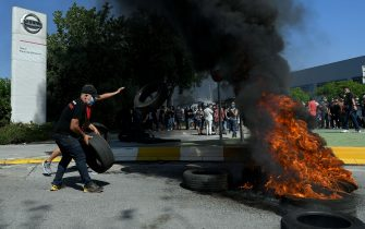 Nissan employees burn tyres in front of the Japanese cars manufacturer's plant in Barcelona on May 28, 2020, as they protest against the factory closure. - Japanese carmaker Nissan has decided to shut its factory in Barcelona where 3,000 people are employed, the Spanish government said today. (Photo by LLUIS GENE / AFP) (Photo by LLUIS GENE/AFP via Getty Images)