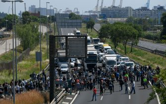 Nissan employees cut off the B-10 highway in Barcelona, as they protest against the closure of the Japanese cars manufacturer's plant in Barcelona on May 28, 2020. - Japanese carmaker Nissan has decided to shut its factory in Barcelona where 3,000 people are employed, the Spanish government said today. (Photo by LLUIS GENE / AFP) (Photo by LLUIS GENE/AFP via Getty Images)
