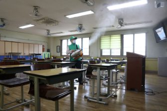 SEOUL, SOUTH KOREA - MAY 19: A disinfection worker sprays anti-septic solution at classroom to prevent the spread of the coronavirus (COVID-19) ahead of school re-opening at Yeouido girl's high school on May 19, 2020 in Seoul, South Korea. Senior high school students are able to return to school from tomorrow, as South Koreans take measures to protect themselves against the spread of coronavirus. South Korea's education ministry announced plans to re-open schools starting for senior high school students, more than two months after schools were closed in a precautionary measure against the coronavirus. According to the Korea Center for Disease Control and Prevention, 13 new cases were reported. The total number of infections in the nation tallies at 11,078. (Photo by Chung Sung-Jun/Getty Images)