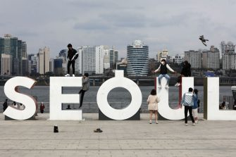 SEOUL, SOUTH KOREA - APRIL 12: People pose for photos on an installation spelling 'Seoul', during a Easter holiday at Yeouido park as South Koreans take measures to protect themselves against the spread of coronavirus (COVID-19) on April 12, 2020 in Seoul, South Korea. South Korea has called for expanded public participation in social distancing, as the country witnesses a wave of community spread and imported infections leading to a resurgence in new cases of COVID-19. South Korea's coronavirus cases hovered around 30 for the third straight day Sunday, but health authorities are still staying vigilant over cluster infections, as well as new cases coming from overseas. According to the Korea Center for Disease Control and Prevention on Sunday, 32 new cases were reported. The total number of infections in the nation tallies at 10,512. (Photo by Chung Sung-Jun/Getty Images)