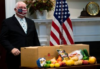 NYTVIRUS -Agriculture Secretary Sonny Perdue wears a mask as he waits for President Donald Trump to deliver remarks on supporting our Nation's Farmers, Ranchers, and Food Supply Chain in the Roosevelt Room of the White House, Tuesday, May 19, 2020.  ( Photo by Doug Mills/The New York Times)