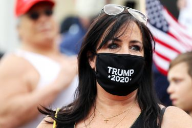 BOSTON, MASSACHUSETTS - MAY 04: A protestor wears a Trump 2020 face mask during a Reopen Massachusetts Rally outside of the Massachusetts State House on May 04, 2020 in Boston, Massachusetts. The coronavirus (COVID-19) pandemic has caused caused closure of all non-essential businesses in the state since March 23. Over 60,000 people have tested positive for COVID-19 in Massachusetts.  (Photo by Maddie Meyer/Getty Images)