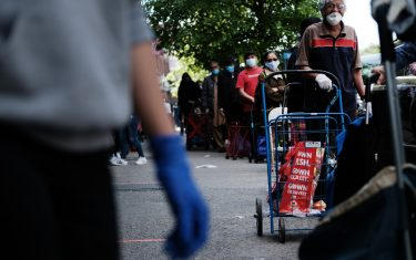 NEW YORK, NY - MAY 22: People wait on line for food outside of a Brooklyn mosque and cultural center on May 22 , 2020 in New York City. The center distributes food from local food banks and charities to anyone in need and usually sees up to 2000 people during a distribution, a number that continues to rise with New Yorker's needs.The number of people going hungry in the five boroughs has risen sharply during the COVID-19 pandemic and city officials have said that up to 2 million New Yorkers currently face food insecurity. (Photo by Spencer Platt/Getty Images)