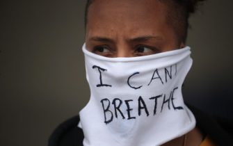 "MINNEAPOLIS, MINNESOTA - MAY 29: A person wears a mask that reads ""I CAN'T BREATHE"" as demonstrators continue to protest the death of George Floyd following a night of rioting on May 29, 2020 in Minneapolis, Minnesota. Earlier today, former Minneapolis police officer Derek Chauvin was taken into custody for Floyd's death. Chauvin has been accused of kneeling on Floyd's neck as Floyd pleaded with him about not being able to breathe. Floyd was pronounced dead a short while later. Chauvin and 3 other officers, who were involved in the arrest, were fired from the police depart after a video of the arrest was circulated.   Scott Olson/Getty Images/AFP == FOR NEWSPAPERS, INTERNET, TELCOS & TELEVISION USE ONLY =="