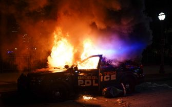 ATLANTA, GA - MAY 29: A police car burns during a protest on May 29, 2020 in Atlanta, Georgia. Demonstrations are being held across the US after George Floyd died in police custody on May 25th in Minneapolis, Minnesota.   Elijah Nouvelage/Getty Images/AFP == FOR NEWSPAPERS, INTERNET, TELCOS & TELEVISION USE ONLY ==
