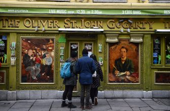 DUBLIN, IRELAND - MARCH 10: Tourists check to see if a bar in the Temple Bar district is open following the cancellation of the annual Saint Patricks Day parade and celebrations on March 17, 2020 in Dublin, Ireland. The event that draws thousands of visitors to the island from across the world was cancelled by the Irish government in their response to the Covid-19 virus pandemic. (Photo by Charles McQuillan/Getty Images)