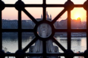 The sun rises behind the oldest Hungarian bridge, the 'Lanchid' (Chain Bridge) in Budapest on April 3, 2020, amid the new coronavirus / Covid-19 pandemic. - Hungary's parliament on Monday, March 30, 2020 approved a bill giving nationalist premier Viktor Orban sweeping powers he says are necessary to fight the new coronavirus pandemic but which critics have condemned as a power grab. (Photo by ATTILA KISBENEDEK / AFP) (Photo by ATTILA KISBENEDEK/AFP via Getty Images)