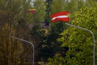 The Latvian and Lithuanian flags are seen at the Latvia-Lithuania border crossing at Skaistkalne, Latvia on May 14, 2020, ahead of border reopening. - After two months of coronavirus-related restrictions, the Baltic States agreed to lift travel restrictions and ensure free movement of their residents by land, sea and air: the so-called 'Baltic Bubble' from May 15, 2020. (Photo by Gints Ivuskans / AFP) (Photo by GINTS IVUSKANS/AFP via Getty Images)