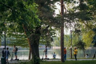 Romanians enjoy a day in a park, that has just reopened, in Bucharest's city center on the first day that the lockdown imposed to stop the spread of the new coronavirus is lifted, on May 15, 2020. (Photo by Andrei PUNGOVSCHI / AFP) (Photo by ANDREI PUNGOVSCHI/AFP via Getty Images)