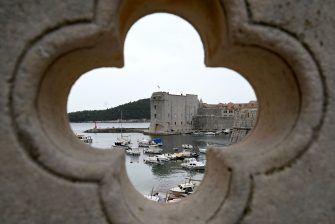 """This picture taken on May 17, 2020, shows a port in the old town of the city of Dubrovnik, on the Adriatic coast of Croatia. - Less than two months after detecting its first infection, Montenegro is the first country in Europe to declare itself coronavirus-free, a success story the tiny country hopes will lure tourists to its dazzling Adriatic coast this summer. Tourism operators have already seized the opportunity to brand Montenegro as """"Europe's First COVID-19 Free Country"""" in videos promoting its stunning natural beauty, with beaches snaking along the south and rugged mountains in the north. Up the coast, tourism powerhouse Croatia is also hoping to capitalise on its relatively low virus numbers to salvage the 2020 season. (Photo by DENIS LOVROVIC / AFP) (Photo by DENIS LOVROVIC/AFP via Getty Images)"""