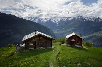 A picture taken on May 14, 2020 shows two chalet at the Alpine village of Gspon. (Photo by Fabrice COFFRINI / AFP) (Photo by FABRICE COFFRINI/AFP via Getty Images)