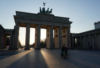 BERLIN, GERMANY - APRIL 07: A couple shoot a selfie at the Brandenburg Gate, one of the city's main landmarks and a popular tourist destination, during the coronavirus crisis on April 7, 2020 in Berlin, Germany. The number of confirmed coronavirus cases in Germany has surpassed 100,000 and the number of deaths continues to rise. While public support for the measures imposed by authorities to limit public life in an effort to slow the spread of virus remains strong, people are wondering how long the measures will last, especially as the economic impact of the disruptions becomes more acute. (Photo by Sean Gallup/Getty Images)