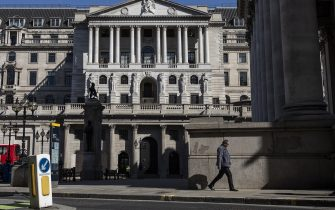 LONDON, ENGLAND - JUNE 01: A man walks past the Bank of England on June 01, 2020 in London, England. The British government further relaxed Covid-19 quarantine measures in England this week, allowing groups of six people from different households to meet in parks and gardens, subject to social distancing rules. Many schools also reopened and vulnerable people who are shielding in their homes are allowed to go outside again. (Photo by Dan Kitwood/Getty Images)
