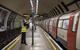 LONDON, ENGLAND - JUNE 01: A worker sanitizes at Clapham Common station on June 01, 2020 in London, England. The British government further relaxed Covid-19 quarantine measures in England this week, allowing groups of six people from different households to meet in parks and gardens, subject to social distancing rules. Many schools also reopened and vulnerable people who are shielding in their homes are allowed to go outside again. (Photo by Dan Kitwood/Getty Images)