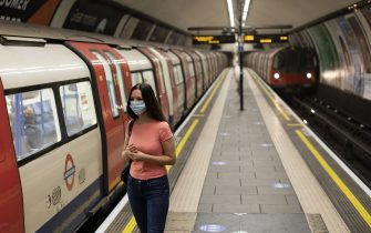 LONDON, ENGLAND - JUNE 01: A woman wearing a face mask waits to board a train at Clapham Common underground on June 01, 2020 in London, England. The British government further relaxed Covid-19 quarantine measures in England this week, allowing groups of six people from different households to meet in parks and gardens, subject to social distancing rules. Many schools also reopened and vulnerable people who are shielding in their homes are allowed to go outside again. (Photo by Dan Kitwood/Getty Images)