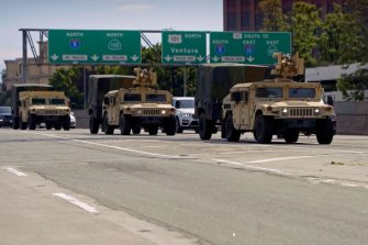 California National Guard armed vehicules are seen on the freeway as they patrol after demonstrators protested the death of George Floyd in Los Angeles, California on May 31, 2020. - Thousands of National Guard troops patrolled major US cities  after five consecutive nights of protests over racism and police brutality that boiled over into arson and looting, sending shock waves through the country. The death Monday of an unarmed black man, George Floyd, at the hands of police in Minneapolis ignited this latest wave of outrage in the US over law enforcement's repeated use of lethal force against African Americans -- this one like others before captured on cellphone video. (Photo by Agustin PAULLIER / AFP) (Photo by AGUSTIN PAULLIER/AFP via Getty Images)