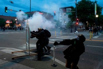 Demonstrators throw rocks at police officers during a protest in Denver, Colorado on May 31, 2020, while protesting the death of George Floyd, an unarmed black man who died while while being arrested and pinned to the ground by the knee of a Minneapolis police officer. - Thousands of National Guard troops patrolled major US cities  after five consecutive nights of protests over racism and police brutality that boiled over into arson and looting, sending shock waves through the country. The death Monday of an unarmed black man, George Floyd, at the hands of police in Minneapolis ignited this latest wave of outrage in the US over law enforcement's repeated use of lethal force against African Americans -- this one like others before captured on cellphone video. (Photo by Jason Connolly / AFP) (Photo by JASON CONNOLLY/AFP via Getty Images)