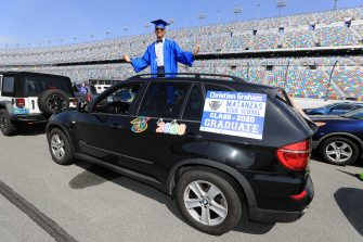 DAYTONA BEACH, FLORIDA - MAY 31:  Graduates of Matanzas High School receive their diplomas on the track in their cars at Daytona International Speedway on May 31, 2020 in Daytona Beach, Florida. (Photo by Sam Greenwood/Getty Images)