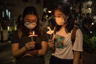 People burn candles during a mass outside a church in Hong Kong on June 4, 2020, to mark the 31st anniversary of the 1989 Tiananmen crackdown in Beijing. (Photo by DALE DE LA REY / AFP) (Photo by DALE DE LA REY/AFP via Getty Images)