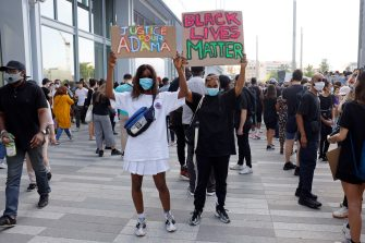 """PARIS, FRANCE - JUNE 02: Protesters gather for a demonstration after French medical experts exonerated the gendarme involved in the arrest of Adama Traore, a young black man who died in police custody in 2016, outside the """"Tribunal de Paris"""" courthouse on June 02, 2020 in Paris, France. (Photo by Pierre Suu/Getty Images)"""