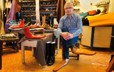 epa08466338 Romanian shoemaker Grigore Lup poses while wearing a pair of men's social-distancing shoes he invented during the Coronavirus pandemic, at his workshop, in Cluj Napoca city, 500 kms north-west of  Bucharest, Romania, 04 June 2020 (issued 05 June 2020). Lup, 55, invented the social distancing shoes in a bid to save his small business in the midst of the Coronavirus crisis. The shoemaker is manufacturing by hand each pair of social distancing shoes, measuring 75 centimeters, using the best natural leather, hand tools plus his 39 years professional experience. After receiving attention from the local media, he began to receive orders from around the world. Most of his customers are confessing that they want to wear his creations on the street or at special occasions. The master shoemaker, who managed to survive the global financial crisis of 2008 by moving from normal shoes to the production of footwear for dance companies and theaters, turned the disadvantage of the Covid-19 pandemic in his favor, producing social distance shoes for both men and women. He is selling a pair of his special shoes for about 100 euros.  EPA/Alexandru Pop To go with the story: 'Number 75 shoes to enforce social distance' by Marcel Gascon/EFE