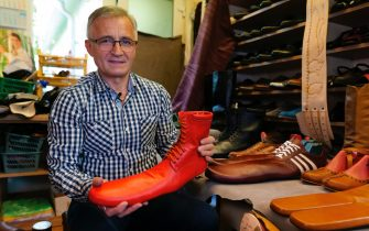 epa08466339 Romanian shoemaker Grigore Lup presents a  unusual women's long shoe he invented during the Coronavirus pandemic, at his workshop, in Cluj Napoca city, 500 kms north-west of Bucharest, Romania, 04 June 2020 (issued 05 June 2020). Lup, 55, invented the social distancing shoes in a bid to save his small business in the midst of the Coronavirus crisis. The shoemaker is manufacturing by hand each pair of social distancing shoes, measuring 75 centimeters, using the best natural leather, hand tools plus his 39 years professional experience. After receiving attention from the local media, he began to receive orders from around the world. Most of his customers are confessing that they want to wear his creations on the street or at special occasions. The master shoemaker, who managed to survive the global financial crisis of 2008 by moving from normal shoes to the production of footwear for dance companies and theaters, turned the disadvantage of the Covid-19 pandemic in his favor, producing social distance shoes for both men and women. He is selling a pair of his special shoes for about 100 euros.  EPA/Alexandru Pop To go with the story: 'Number 75 shoes to enforce social distance' by Marcel Gascon/EFE