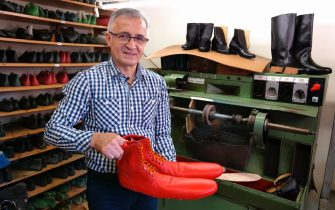 epa08466347 Romanian shoemaker Grigore Lup, presents a pair of unusual women's long shoes he invented during the coronavirus pandemic, at his workshop, in Cluj Napoca city, 500 Km North-West from Bucharest, Romania, 04 June 2020 (issued 05 June 2020). Lup, 55, invented the social distancing shoes in a bid to save his small business in the midst of the coronavirus crisis. The shoemaker is manufacturing by hand each pair of social distancing shoes, measuring 75 centimeters, using the best natural lether , hand tools plus his 39 years proffesional experience. After receiving attention from the local media, he began to receive orders from around the world, most of his customers confessing that they want to wear his creations on the street or at special occasions. The master shoemaker, who managed to survive the global financial crisis of 2008 by moving from normal shoes to the production of footwear for dance companies and theaters, turned the disadvantage of the covid pandemic in his favor, producing social distance shoes for both men and women. He is selling a pair of his special shoes for about 100 euros.  EPA/Alexandru Pop To go with the story: 'Number 75 shoes to enforce social distance' by Marcel Gascon/EFE