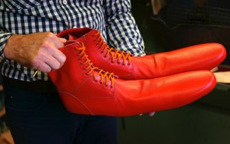 epa08466346 Romanian shoemaker Grigore Lup presents a pair of women's social-distancing red boots  he created and produced during the Coronavirus pandemic, at his workshop, in Cluj Napoca city, 500 kms north-west of Bucharest, Romania, 04 June 2020 (issued 05 June 2020). Lup, 55, invented the social distancing shoes in a bid to save his small business in the midst of the Coronavirus crisis. The shoemaker is manufacturing by hand each pair of social distancing shoes, measuring 75 centimeters, using the best natural leather, hand tools plus his 39 years professional experience. After receiving attention from the local media, he began to receive orders from around the world. Most of his customers are confessing that they want to wear his creations on the street or at special occasions. The master shoemaker, who managed to survive the global financial crisis of 2008 by moving from normal shoes to the production of footwear for dance companies and theaters, turned the disadvantage of the Covid-19 pandemic in his favor, producing social distance shoes for both men and women. He is selling a pair of his special shoes for about 100 euros.  EPA/Alexandru Pop To go with the story: 'Number 75 shoes to enforce social distance' by Marcel Gascon/EFE