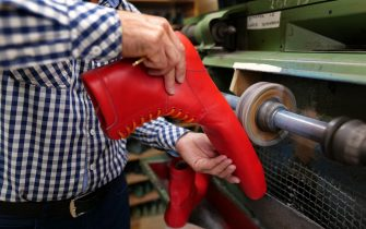epa08466343 Romanian shoemaker Grigore Lup works at a pair of unusual women's long shoes he created during the Coronavirus pandemic, at his workshop, in Cluj Napoca city, 500 kms north-west of Bucharest, Romania, 04 June 2020 (issued 05 June 2020). Lup, 55, invented the social distancing shoes in a bid to save his small business in the midst of the Coronavirus crisis. The shoemaker is manufacturing by hand each pair of social distancing shoes, measuring 75 centimeters, using the best natural leather, hand tools plus his 39 years professional experience. After receiving attention from the local media, he began to receive orders from around the world. Most of his customers are confessing that they want to wear his creations on the street or at special occasions. The master shoemaker, who managed to survive the global financial crisis of 2008 by moving from normal shoes to the production of footwear for dance companies and theaters, turned the disadvantage of the Covid-19 pandemic in his favor, producing social distance shoes for both men and women. He is selling a pair of his special shoes for about 100 euros.  EPA/Alexandru Pop To go with the story: 'Number 75 shoes to enforce social distance' by Marcel Gascon/EFE
