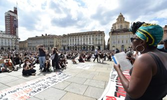 Protesters holding placards attend a demonstration against racism and in memory of George Floyd in Castello Square, in Turin, Italy, 06 June 2020. The protesters gather to demonstrate in the wake of the death in police custody of George Floyd in the United States. ANSA/ ALESSANDRO DI MARCO