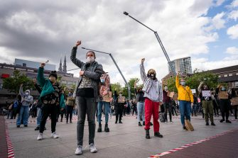 epa08469540 Demonstrators wear face masks as they raise their fists while taking part in a protest at the Stadhuisplein square in Eindhoven, The Netherlands, 06 June 2020. The anti-racism demonstration was held to condemn the killing of George Floyd, a 46-year-old African-American man who died on 25 May after being detained by police officers in Minneapolis (Minnesota), and to express solidarity with the Black Lives Matter-led protests currently taking place throughout the USA.  EPA/ROB ENGELAAR