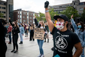 epa08469539 Demonstrators wear face masks as they raise their fists while taking part in a protest at the Stadhuisplein square in Eindhoven, The Netherlands, 06 June 2020. The anti-racism demonstration was held to condemn the killing of George Floyd, a 46-year-old African-American man who died on 25 May after being detained by police officers in Minneapolis (Minnesota), and to express solidarity with the Black Lives Matter-led protests currently taking place throughout the USA.  EPA/ROB ENGELAAR