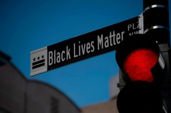 """A new street sign that reads """"Black Lives Matter Plaza NW"""" can be seen at the intersection of H and 16th Street near the White House in Washington DC, on June 5, 2020. - Washington mayor Muriel Bowser on June 5 renamed an area near the White House that has become the epicenter of anti-racism protests over the past week """"Black Lives Matter Plaza"""" -- unveiling a giant street mural. (Photo by ROBERTO SCHMIDT / AFP) (Photo by ROBERTO SCHMIDT/AFP via Getty Images)"""