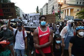 WASHINGTON, DC - JUNE 05: Demonstrators gather on 16th St. near Lafayette Park during a peaceful protest against police brutality and the death of George Floyd, on June 5, 2020 in Washington, DC. Protests in cities throughout the country have been largely peaceful in the wake of the death of George Floyd, a black man who was killed in police custody in Minneapolis on May 25. (Photo by Tasos Katopodis/Getty Images)