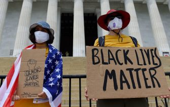 Demonstrators hold placards at the Lincoln Memorial during a protest against racism and police brutality on June 6, 2020 in Washington, DC. - Demonstrations are being held across the US following the death of George Floyd on  May 25, 2020, while being arrested in Minneapolis, Minnesota. (Photo by Olivier DOULIERY / AFP)