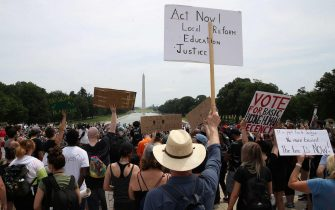 WASHINGTON, DC - JUNE 06: Demonstrators gather in front of the Lincoln Memorial during a protest against police brutality and racism on June 6, 2020 in Washington, DC. This is the 12th day of protests with thousands of people descending on the city to peacefully demonstrate in the wake of the death of George Floyd, a black man who was killed in police custody in Minneapolis on May 25.   Win McNamee/Getty Images/AFP == FOR NEWSPAPERS, INTERNET, TELCOS & TELEVISION USE ONLY ==