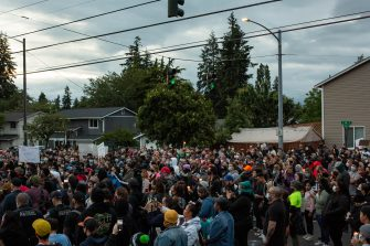 TACOMA, WA - JUNE 03: People listen during a vigil for Manuel Ellis, a black man whose March death while in Tacoma Police custody was recently found to be a homicide, according to the Pierce County Medical Examiners Office, near the site of his death on June 3, 2020 in Tacoma, Washington. Protests and other events sparked by the death of George Floyd have continued in the Tacoma area after the Medical Examiner found that the cause of death in the Manuel Ellis case was caused by respiratory arrest due to hypoxia due to physical restraint. (Photo by David Ryder/Getty Images)