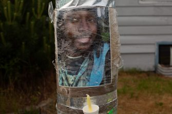 TACOMA, WA - JUNE 03: A photo of Manuel Ellis, a black man whose March death while in Tacoma Police custody was recently found to be a homicide, according to the Pierce County Medical Examiners Office, is seen near the site of his death during a vigil for him on June 3, 2020 in Tacoma, Washington. Protests and other events sparked by the death of George Floyd have continued in the Tacoma area after the Medical Examiner found that the cause of death in the Manuel Ellis case was caused by respiratory arrest due to hypoxia due to physical restraint. (Photo by David Ryder/Getty Images)