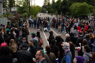 TACOMA, WA - JUNE 03: The crowd makes way for the family to enter at the start of a vigil for Manuel Ellis, a black man whose March death while in Tacoma Police custody was recently found to be a homicide, according to the Pierce County Medical Examiners Office, near the site of his death on June 3, 2020 in Tacoma, Washington. Protests and other events sparked by the death of George Floyd have continued in the Tacoma area after the Medical Examiner found that the cause of death in the Manuel Ellis case was caused by respiratory arrest due to hypoxia due to physical restraint. (Photo by David Ryder/Getty Images)