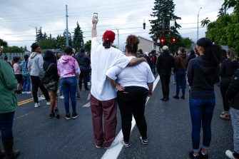 Family, friends and community members attend a vigil at the intersection where Manuel Ellis, a 33-year-old black man, died in Tacoma Police custody on March 3 and was recently ruled a homicide, according to the Pierce County Medical Examiners Office, in Tacoma, Washington on June 3, 2020. - US protesters welcomed new charges brought June 3 against Minneapolis officers in the killing of African American man George Floyd -- but thousands still marched in cities across the country for a ninth straight night, chanting against racism and police brutality. (Photo by Jason Redmond / AFP) (Photo by JASON REDMOND/AFP via Getty Images)